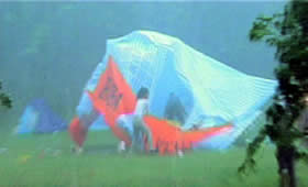 The tent lifts off the ground and collapses