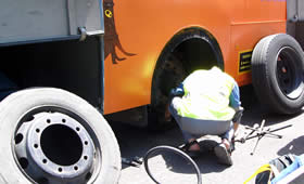 The blown bus tyre being replaced