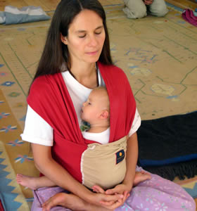 Mother meditating with baby